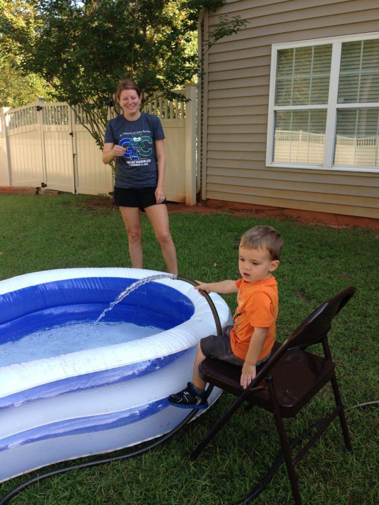 Levi filling up pool